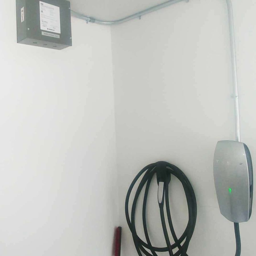 DCC-10 installation in a home with a Tesla Wall Connector.
